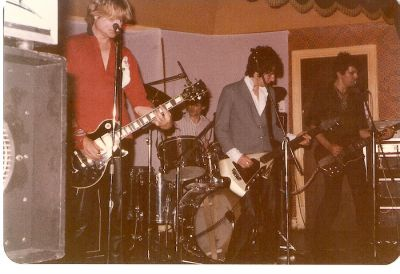 I take centre stage at my inaugurel gig with Brian James and the Brains at the No. 1 Club, Islington, London, 1979. Click image to enlarge.