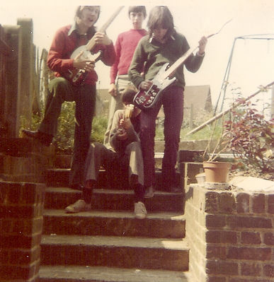 Nuclear Hurricane - my parents' garden, 1973. Jon Easton (left), Alan, the roadie (middle), Me, posing with Top Twenty guitar (right) and John, sitting. Click image to enlarge.